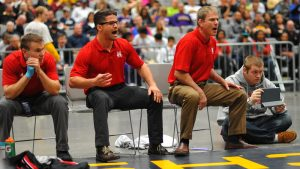 Three coaches yelling