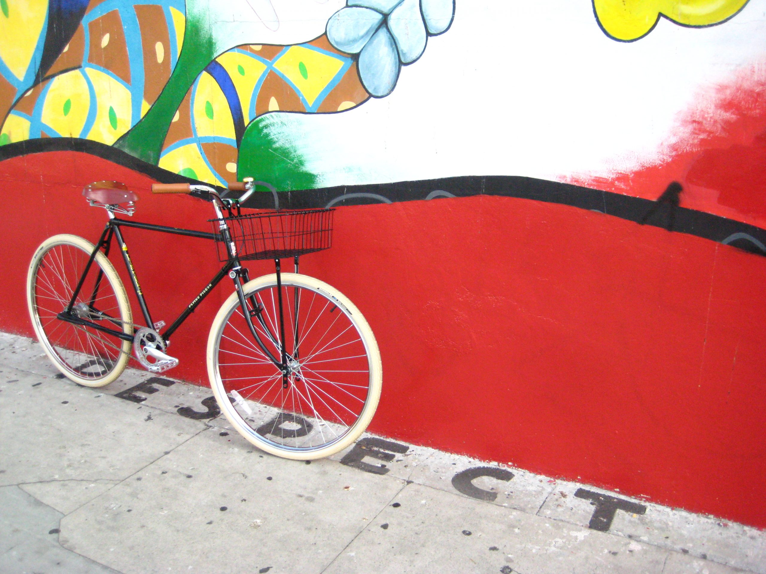 Bicycle against colored wall