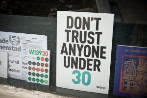 """A sign that says """"Don't trust anyone under 30"""""""