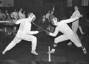 Black and White photo of two people fencing