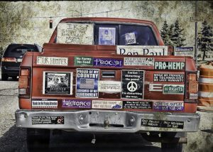 Truck with many political bumper stickers
