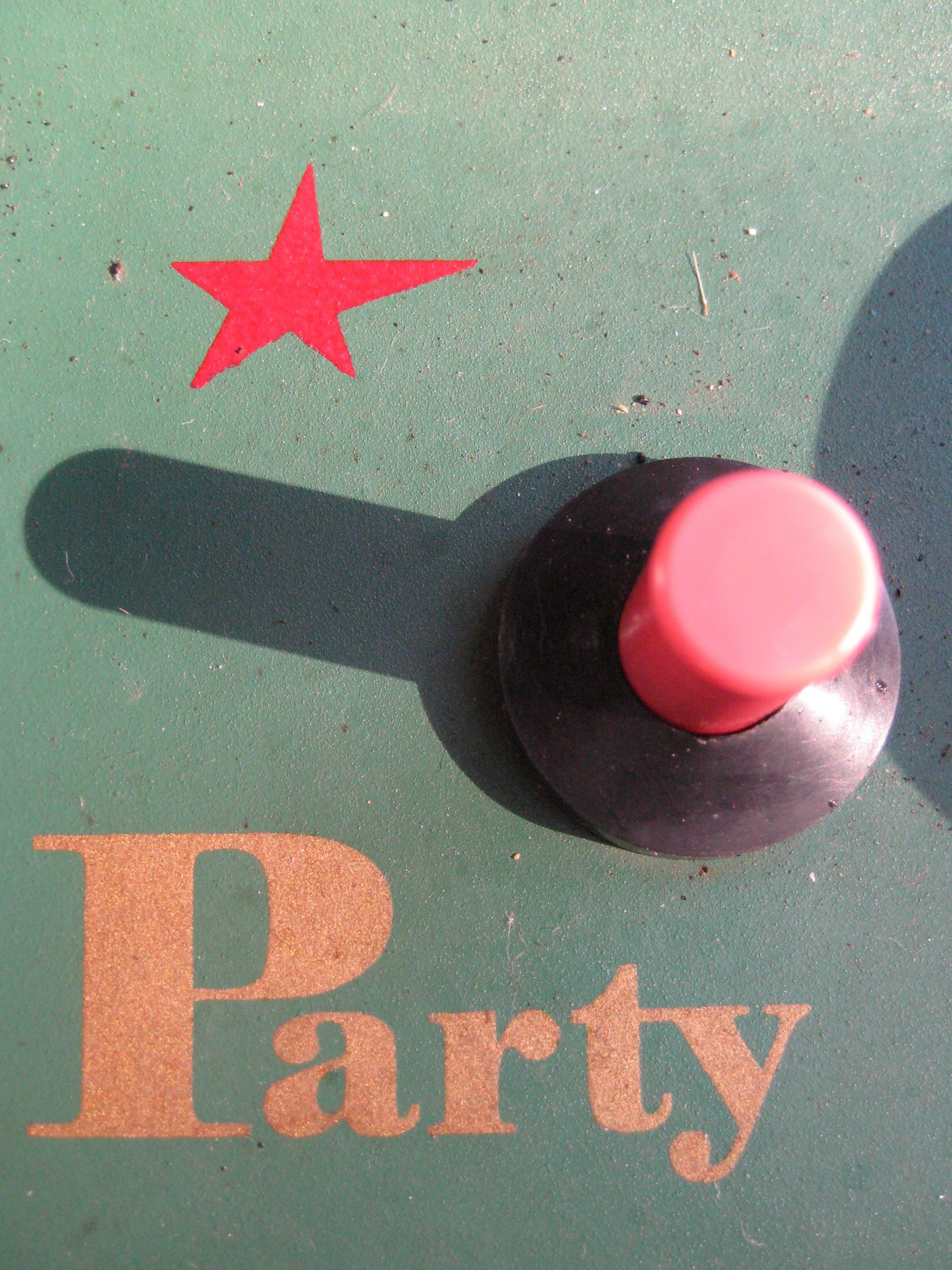 Button with the word 'party' next to it